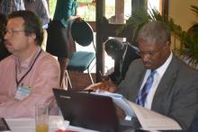 Le chef du cabinet du Directeur General du CONATEL, Monsieur shiller jean Baptiste en train de consulter un document.